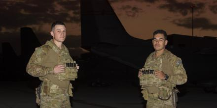 Security and Fire School trainees Aircraftman Mitchyll Flanagan and Jayden Woodley during a patrol of the No. 35 Squadron flight line at RAAF Base Amberley. Photo: Corporal Jesse Kane
