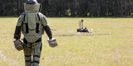 Corporal Randell Costello walks out in an EOD-9 bomb suit to a simulated explosive device during Exercise Regal Burrow at Defence Establishment Orchard Hills. Photo: Corporal Dan Pilhorn
