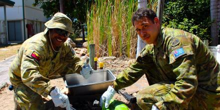 No. 2 Security Forces Squadron Airfield Defence Guard Leading Aircraftman Pryce Mareko, left, and 5 Aviation Regiment Life Support Fitter Craftsman Christopher Morganson at RAAF Base Townsville.