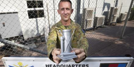 Sergeant Kieran Preston with his silver swab award at the Joint Task Force 633 headquarters in the Middle East . Photo: Corporal Tristan Kennedy