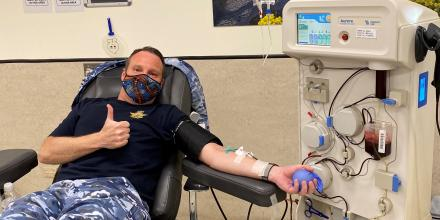 Air Force Band Commanding Officer Squadron Leader Mark Pentreath donates during the Defence Blood Challenge.