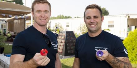 Leading Aircraftman Kyle Buckley, left, and Leading Aircraftman Matthew Kohl with their handmade metal poppies at Camp Baird in the Middle East. Photo: Corporal Tristan Kennedy