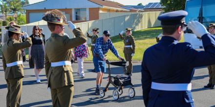 Australia's Federation Guard provides a guard of honour as Sergeant Bert Le-Merton completes his 96km fundraising walk for Soldier On.