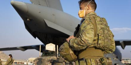 RAAF Corporal Daniel Cafaro guards a RAAF C-17 at Hamid Karzai International Airport in Kabul, Afghanistan. Photo: Corporal Tristan Kennedy