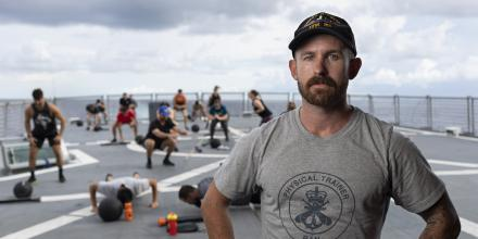 Physical Training Instructor Leading Seaman Matthew Rowe during a training session on HMAS Arunta. Photo: Leading Seaman Jarrod Mulvihill