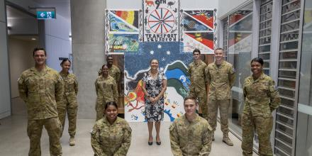 Aunty Lorraine Hatton, centre, with members of the 3rd Combat Service Support Battalion during her visit to 3rd Brigade, Lavarack Barracks, Townsville. Photo: Lily Charles