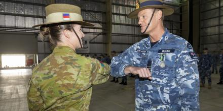 Commander of Joint Task Force 633 Major General Susan Coyle congratulates Wing Commander Matthew Walsh during a Transfer of Authority parade at Camp Baird in the Middle East. Photo: Corporal Tristan Kennedy