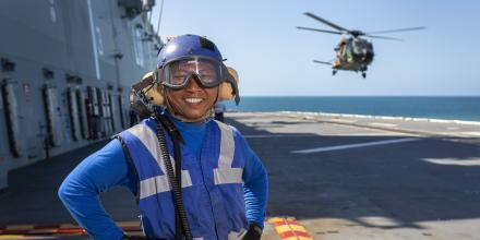 Able Seaman Aviation Support Khin Thaung on the flight deck of HMAS Adelaide during Exercise Sea Wader. Photo: Able Seaman Daniel Goodman