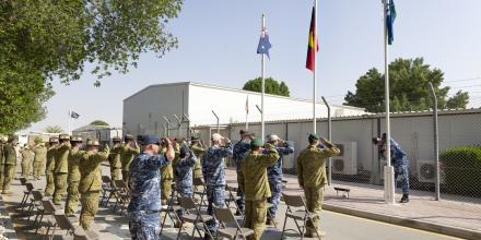 Members of Joint Task Force 633 salute the flags during a NAIDOC Week flag-raising ceremony at Australia's main operating base in the Middle East. Photo: Corporal Tristan Kennedy