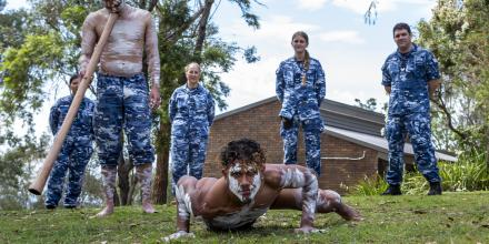 No. 22 Squadron's Indigenous liaison officer Flight Lieutenant Tjapukai Shaw, front left, and his brother Ngali Shaw perform during NAIDOC Week celebrations at RAAF Base Glenbrook, as base personnel look on. Photo:  Corporal Dan Pinhorn