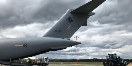 A Caterpillar Challenger traverse tractor is loaded on to a RAAF C-17A Globemaster bound for Antarctica.