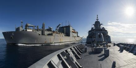 HMAS Arunta, right, conducts a replenishment at sea with United States Naval Ship Amelia Earhart.  Photo: Leading Seaman Jarrod Mulvihill