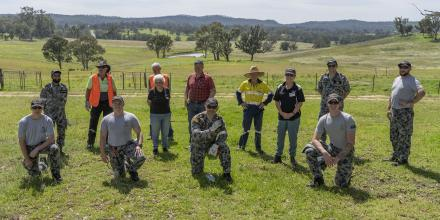 NUSHIP Supply crew with Blaze Aid volunteers and Barry and Nerida Heseltine at their farm in Bega Valley Shire, NSW. Photo: Able Seaman Leon Dafonte Fernandez