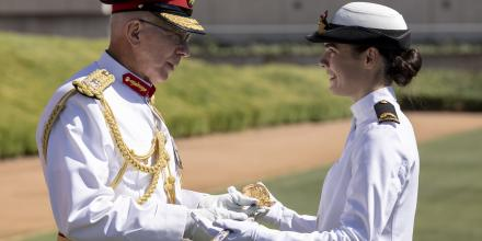 Governor-General General (retd) David Hurley presents the Commander in Chief's Medal and Sword to now Sub Lieutenant Tiffany McCormack during the 2020 ADFA graduation parade on December 6. Photo: Lauren Larking