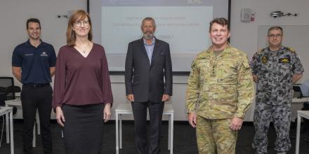Emergency Management Australia's James Drummond, left, Australian Civil-Military Centre's Rachel Walshe, Captain Jim Hutton, Colonel Warwick Young, and Captain Leif Maxfield. Photo: Able Seaman Benjamin Ricketts