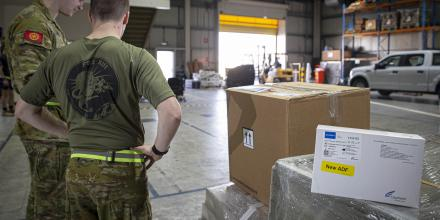 ADF personnel in the Middle East prepare a load of COVID-19 test kits for delivery to Afghanistan. Photo: Sergeant Ben Dempster