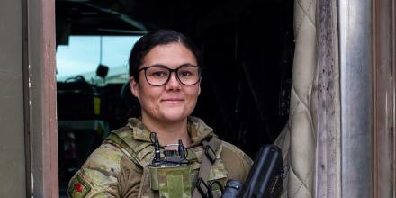 Private Ashleigh Deguara in front of a Protected Mobility Vehicle in Kabul, Afghanistan.