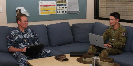 Officer Cadets  James Madden and Daniel Irwin discussing academic assignments in their common room area in the live-in accommodation at the Australian Defence Force Academy. Photo: Midshipman Ed Jewson