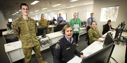 Army personnel at one of the call centre sites, from left, Private Nicholas Rheinberger, Corporal Nathaniel Wood and Corporal Elizabeth Brookes. Photo: Chris Kidd