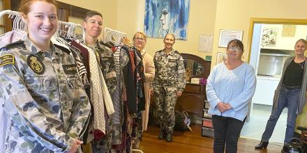 Able Seaman Sophie Langton, left, Petty Officer Casey Smith, Petty Officer Cassandra Duncan and Chief Petty Officer Linda Eddington, with Supported Accommodation and Homelessness Services Shoalhaven & Illawarra volunteers, setting up a donation point.