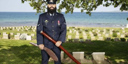 Leading Aircraftman Brodie McIntyre stands at the Ari Burnu Cemetery, Turkey. He is a Warlpiri man and is preparing to represent the Australian Defence Force in Gallipoli this Anzac Day. Photo: Petty Officer Andrew Dakin