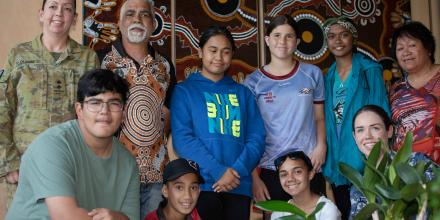 Flying Officer Katie Ryan-Baker, front right, Lieutenant Colonel Meegan Olding, back left, and local Aboriginal artist Eric Ellis, back, second from left, with members of the Hymba Yumba Independent School. Photo: Terry O'Hagan