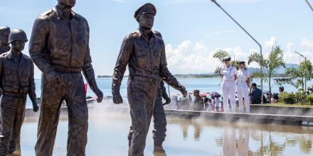 Lieutenant Shannen Rowe, left, and Sub-Lieutenant Rabeca Appelkamp take a moment of reflection at the memorial of the Battle of Leyte Gulf, at the 75th anniversary of the Leyte Landing in Leyte, Philippines. Photo: LSIS Tara Byrne