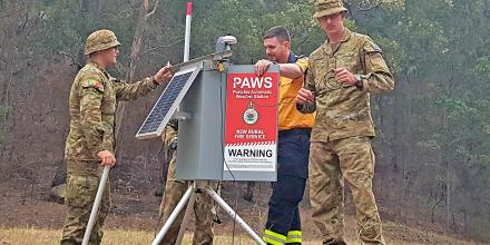 Private Aaron Smith helps RFS officer Major (retd) Nick Shepley and Private Will Asquith set up a Portable Automatic Weather Station at Belowra on the NSW south coast.