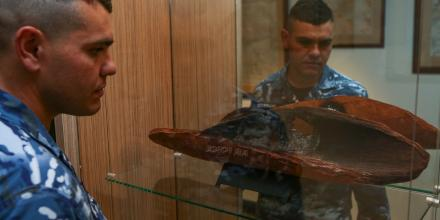 Indigenous Liaison Officer Flight Lieutenant Steven Warrior with one of the artefacts.