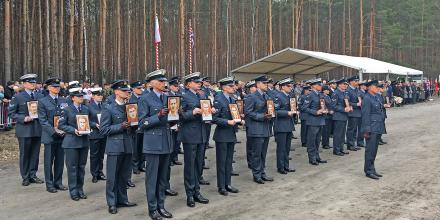Fifty RAF personnel hold portraits of the 50 prisoners of war, executed by the Nazis, during the 75th anniversary of the Great Escape in Poland. Portraits were created by artist Jon England.