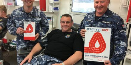 Wing Commander Nicholas Pausina, centre, rolled up his sleeve and donated blood at RAAF Base Wagga.