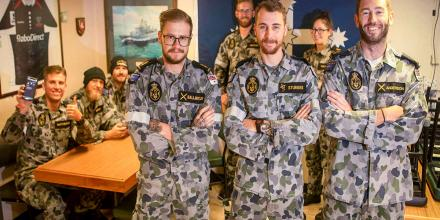 HMAS Ballarat's Quality of Life administration team Able Seaman Adam Ballintijn, front left, Leading Seaman Reece Sturges and Leading Seaman Liam Anderson in the ship's junior sailors' cafe. Photo: Leading Seaman Ernesto Sanchez